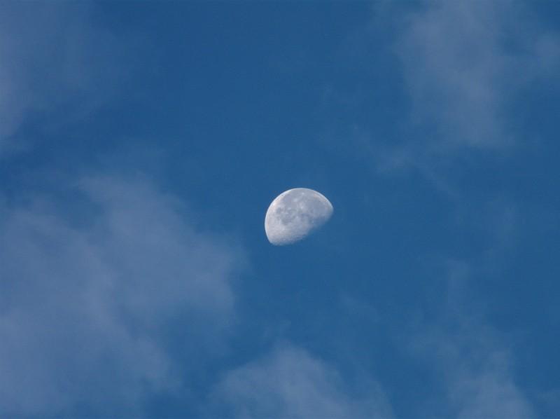 Moon Between Clouds
