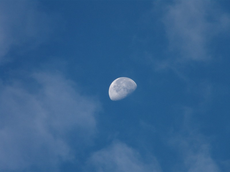 Moon Between Clouds